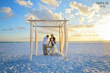 Gulf beach wedding couple during Unity Sand Ceremony