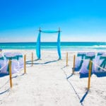 A blue beach wedding ceremony on the Gulf Coast of Florida.