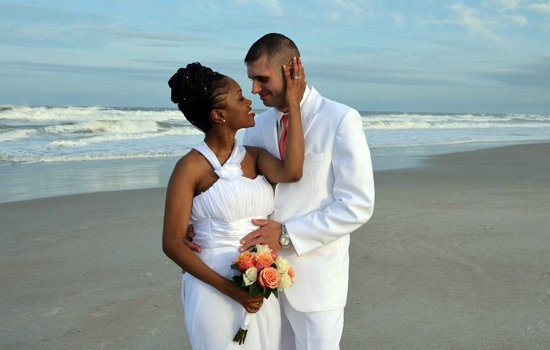 Couple embraces after wedding on Daytona Beach at sundown