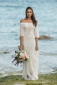 Bride on beach with flowers