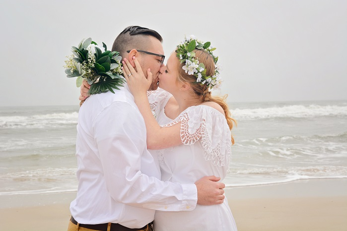 Bohemian bride and groom by the sea