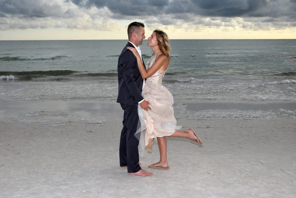 Beach wedding couple in Siesta Key by Gulf