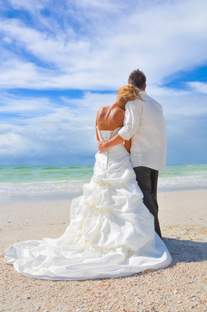 Groom and bride at Clearwater Beach wedding by the Gulf waters