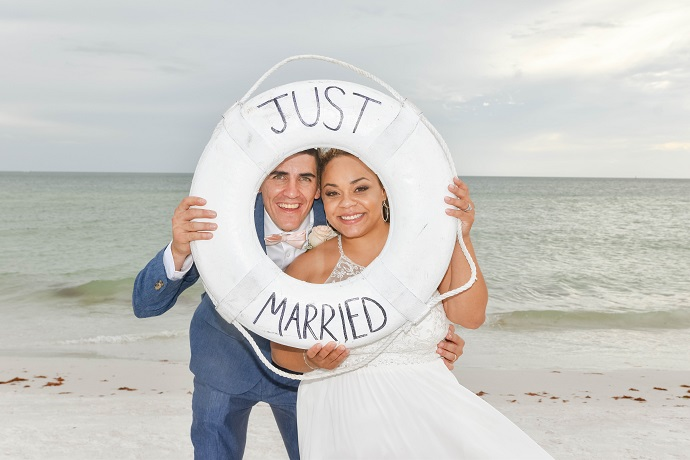 Just Married couple smiles through buoy in Siesta Key