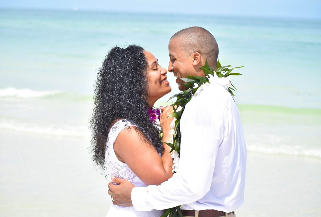 Passe-A-Grill beach wedding couple by the Gulf