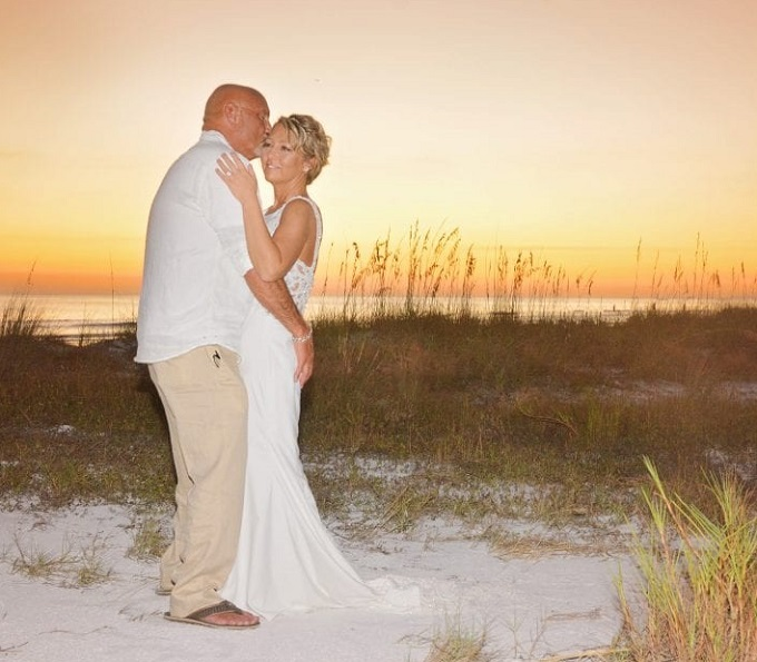 Couple embrace in Siesta Key at sunset wedding on the beach
