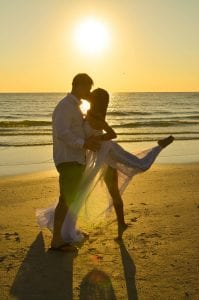 A ballerina poses in front of the sunset after her Siesta Key Beach Weddings ceremony.