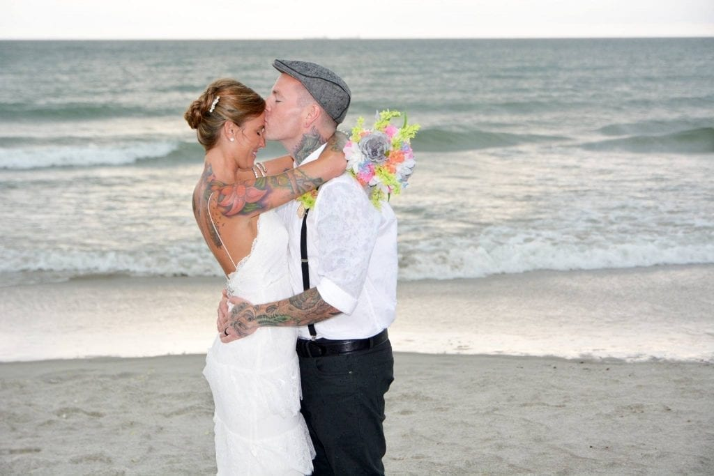 UK couple kiss on Florida beach after wedding in Daytona Beach
