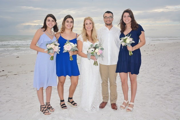 Bridesmaids in short dresses on Daytona Beach