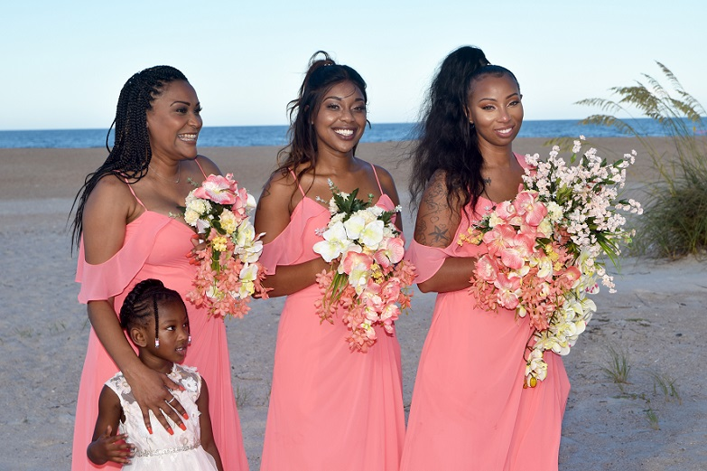 Three Bridesmaids smile in St. Augustine Beach