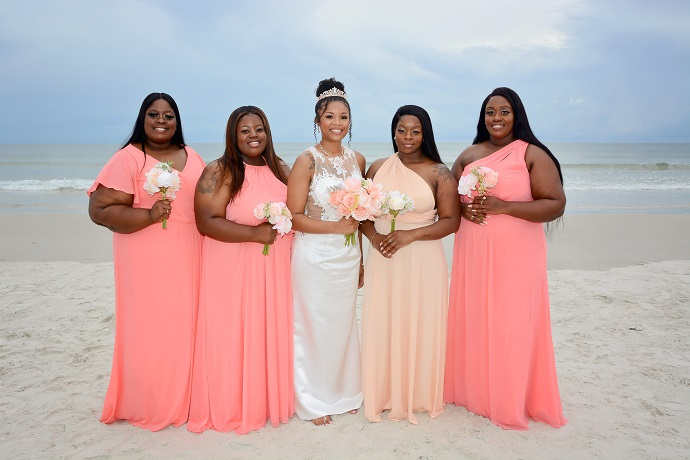 Bridesmaids with bride on Daytona Beach