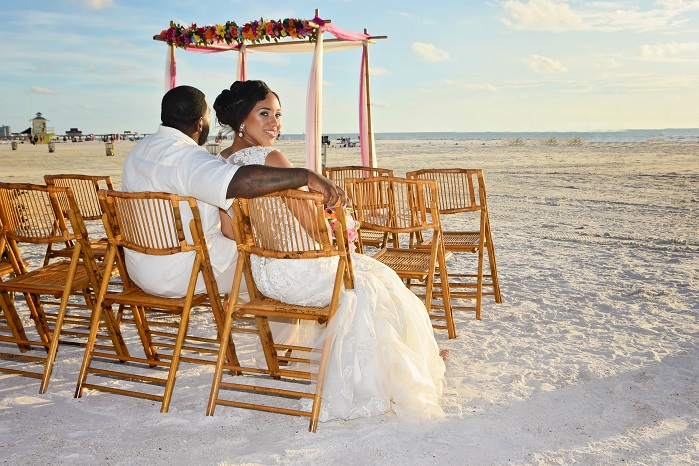 Couple at Clearwater Beach with a Destiny wedding package sitting