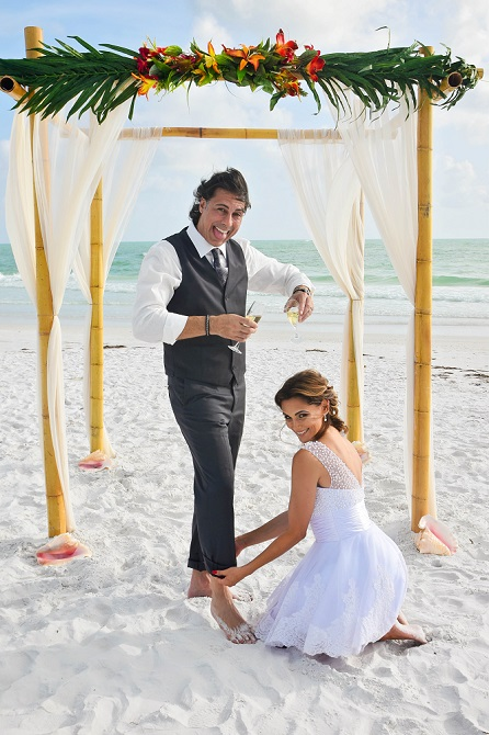 Couple getting married on Siesta Key laughing