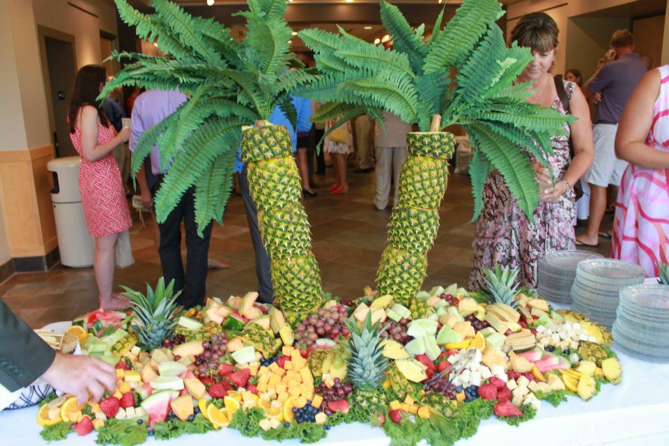Palm tree pineapples and fruit for wedding guests