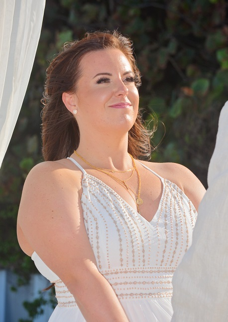 Beautiful smiling beach bride saying vows in Florida