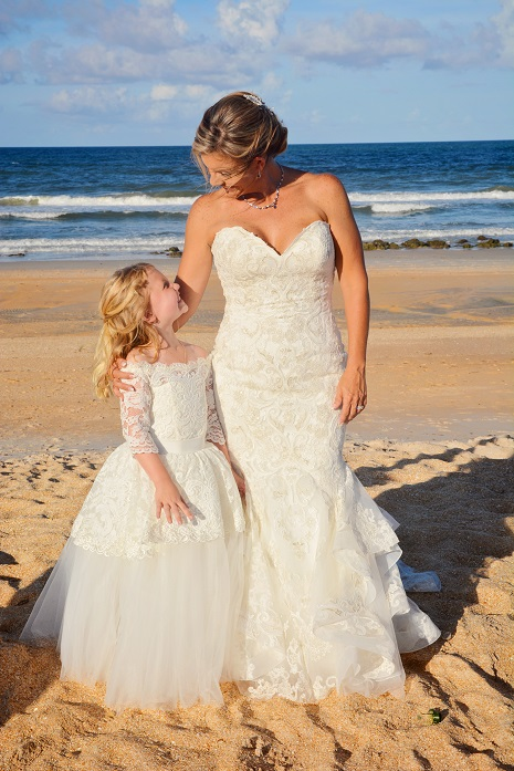 Bride and Flower girl at Florida Beach wedding St. Augustine by ocean