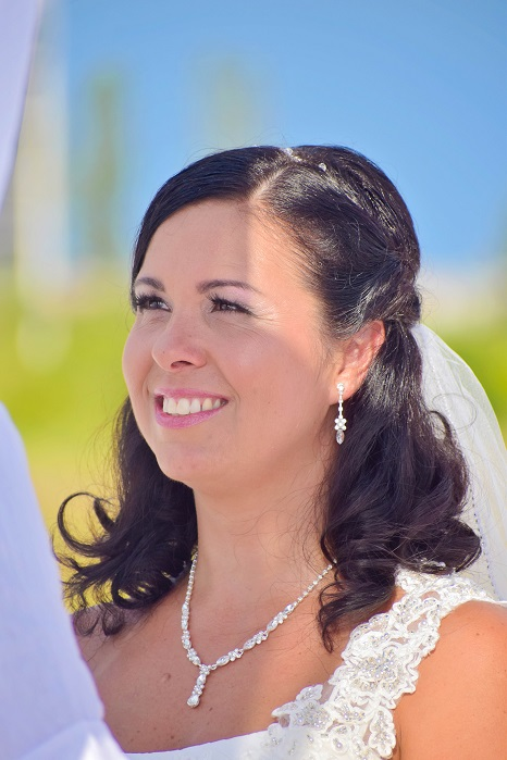 Bride on the beach smiling in Florida