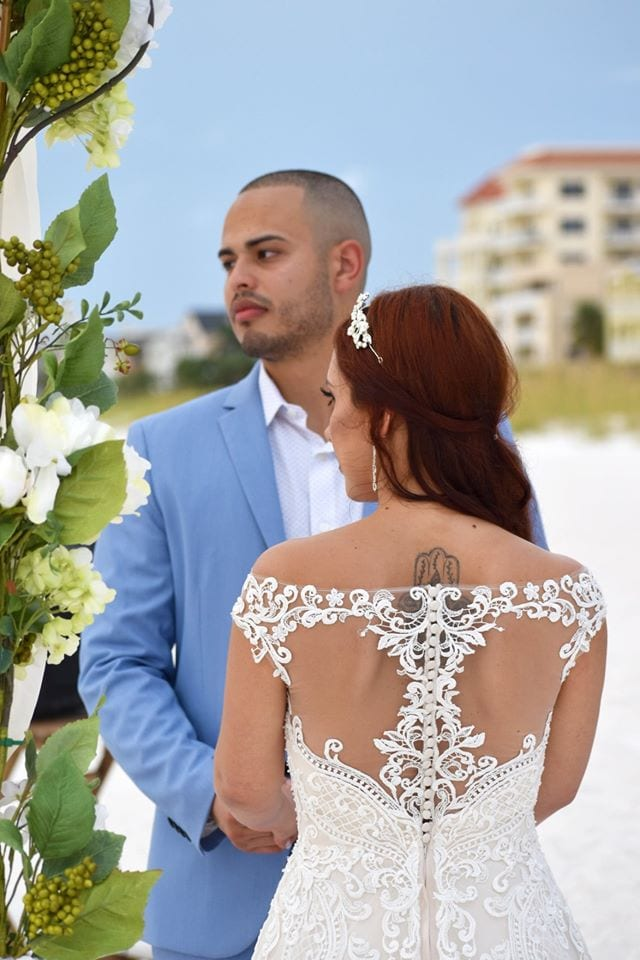 Groom Clearwater Beach Wedding saying vows