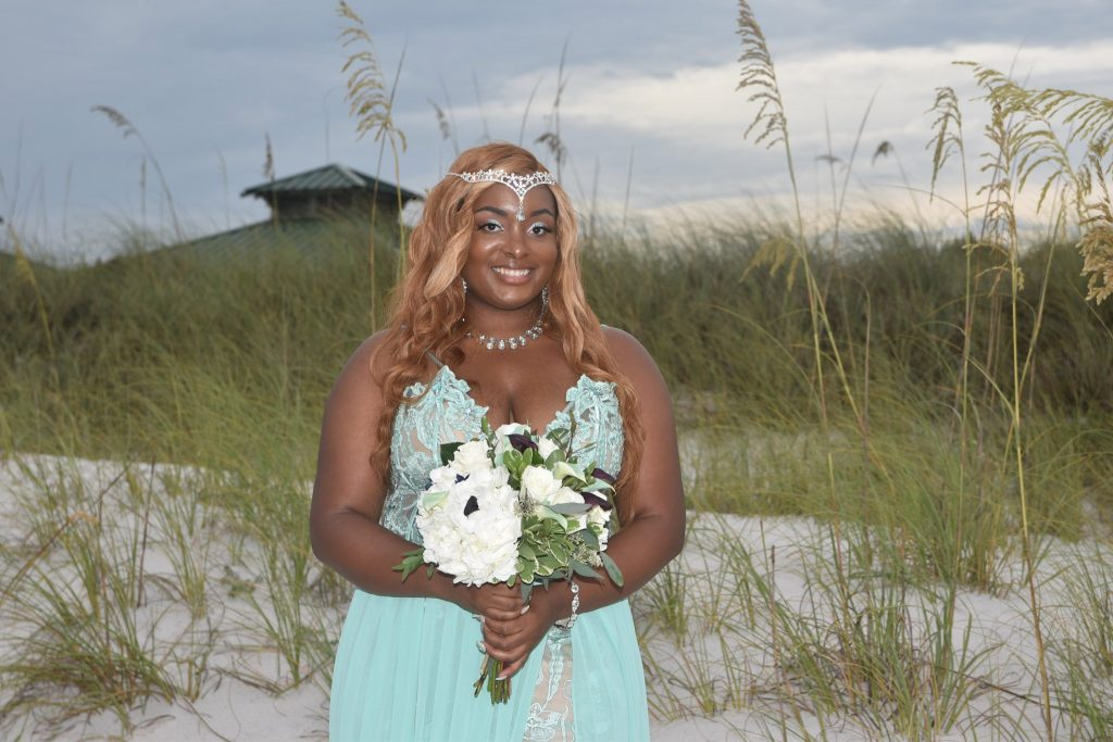 Destin bride holding bouquet at beach wedding in Florida
