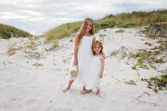 Flower Girls by dunes at Florida beach wedding