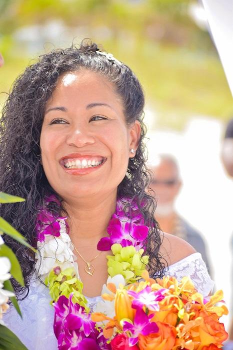 Happy beach bride wearing flowers in Florida