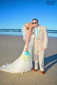 A brides kiss is featured by our Forever In Love photographer at one of the Destination Weddings in Florida.