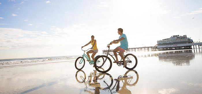 Couple rides bikes on Daytona Beach