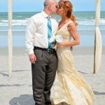 A bride and groom share a kiss during one of our Florida Beach Elopements.
