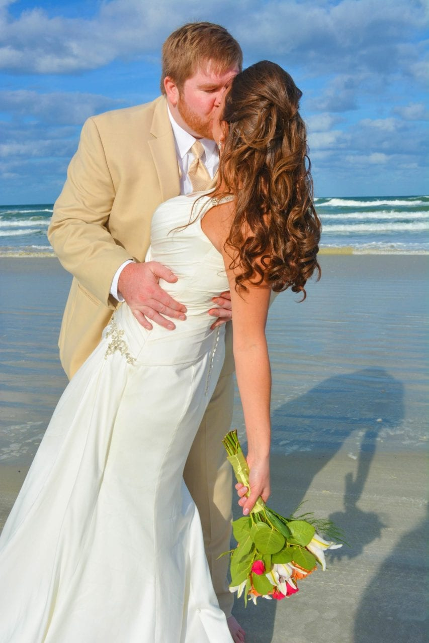 Wedding couple kissing on Indian Rocks Beach, Florida