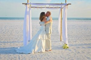 A bride adn groom share a kiss during one of our Florida Beach elopements.