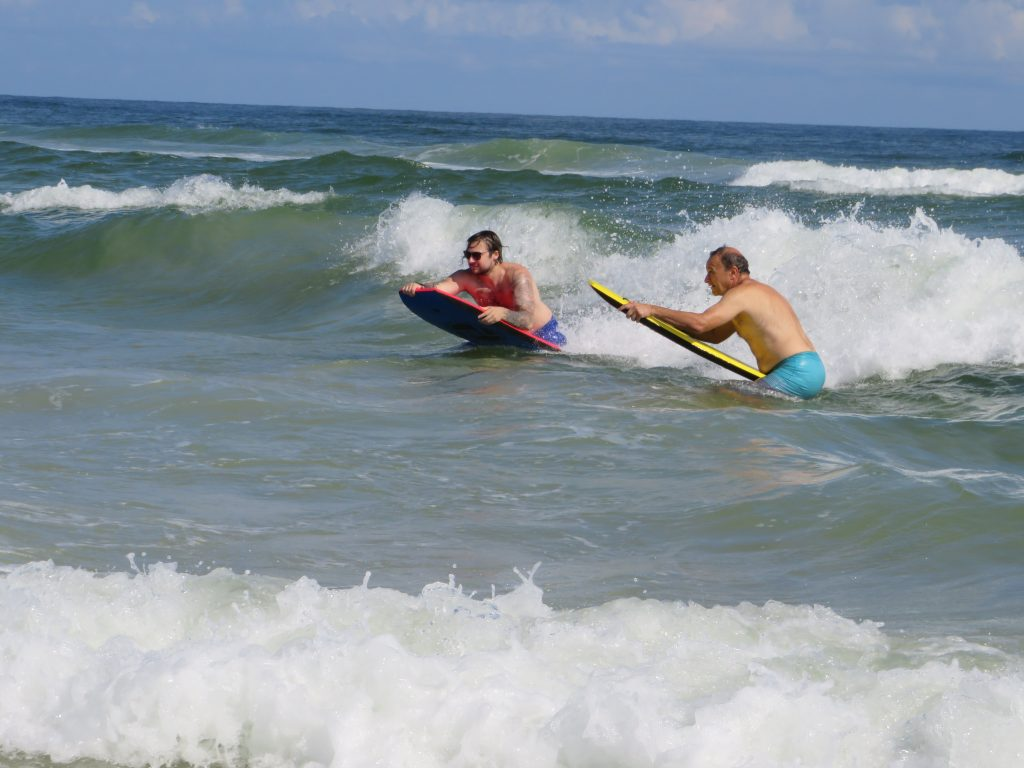 Two surfers in Atlantic on Daytona Beach