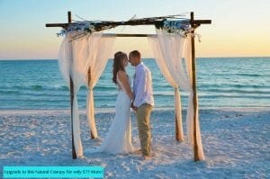 Florida Beach Elopements with a natural bamboo canopy and branch topper.