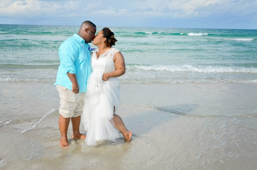 A bride and groom share a kiss during their Daytona Beach Wedding