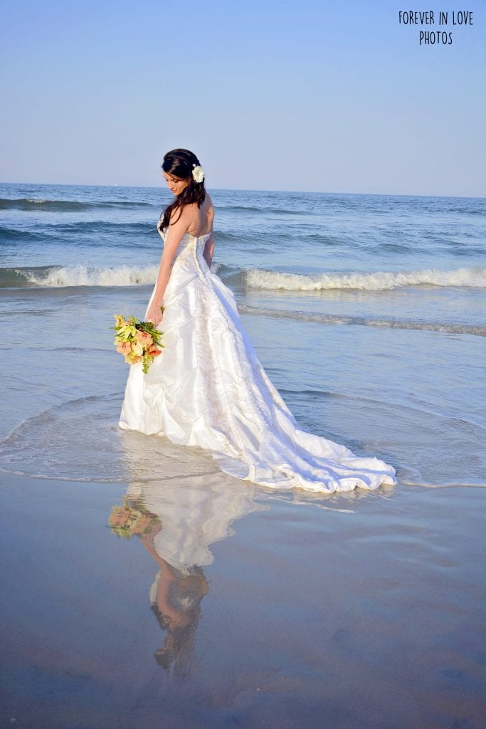 A bride poses for her Daytona Beach Weddings Photography.