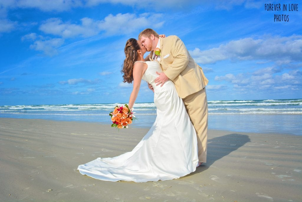 Daytona Beach Weddings exclusive photographer poses the bride and groom.