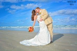 Daytona Beach Weddings exclusive photographer poses the bride and groom.