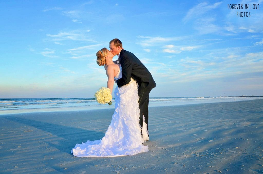 Daytona Beach Weddings are the ideal spot for a groom to dip his bride.