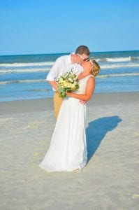 a bride and groom pose for their Daytona Beach Weddings photography session.