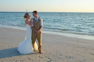 Clearwater Beach Weddings with photography include elegant poses like this bride and groom exchanging glances.