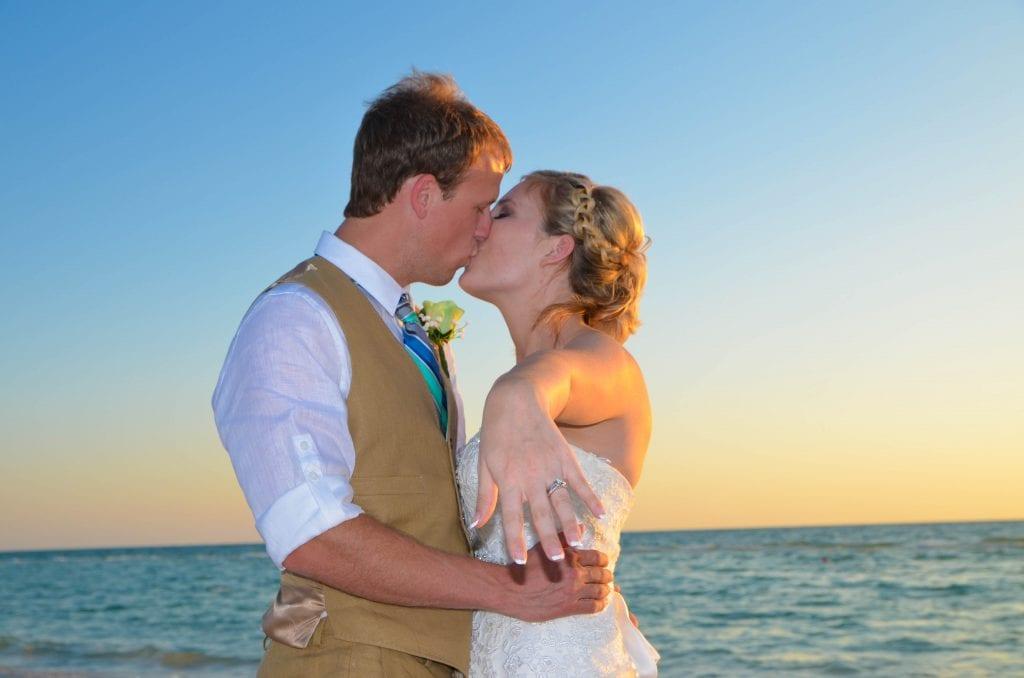 Wedding couple kissing on Florida beach