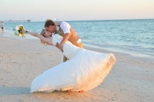 A groom dips his bride during one of our Clearwater Beach Weddings.