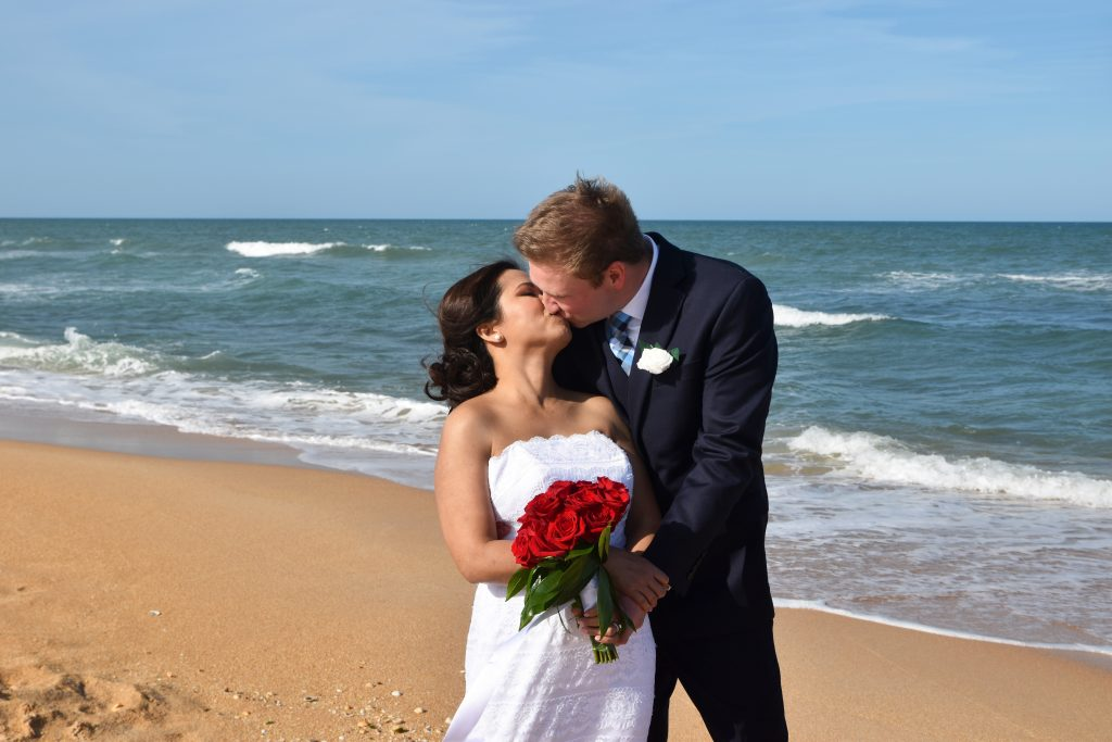 Cocoa Beach bride and groom kissing