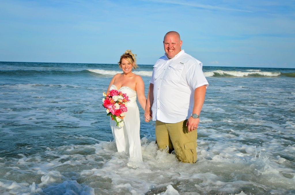 St. Augustine beach wedding couple in the ocean