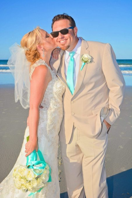 Bride kissing groom at beach wedding in St. Augustine