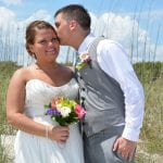 Cocoa Beach Weddings also provide you with beautiful dunes for your beach wedding photos. This bride and groom pose by the dunes in Cocoa Beach.