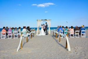 Cocoa Beach Weddings with natural beach wedding decor and officiant.
