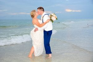 Siesta Key beach weddings are a great way to dip your toes in the ocean and share a kiss.