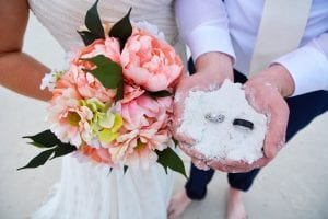 Check out the white sand of our Siesta Key Beach weddings and this bride and grooms ring.