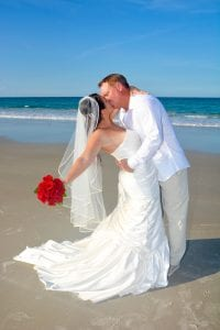 Sharing a kiss during one of our Daytona Beach Weddings in Florida.