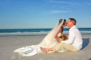 Daytona Beach Weddings on the ocean are meant for posing like this sweet bride and groom kissing.